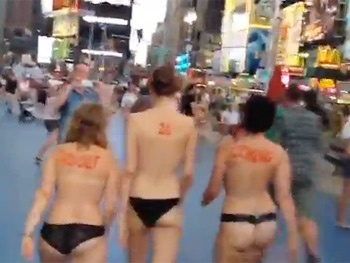 Bullet Director Woody Harrelson Parades Topless Women in Times Square to Announce 'Adolf Is Coming!'