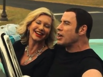 Grease Stars John Travolta & Olivia Newton-John Reunite for Wacky Holiday Music Video 