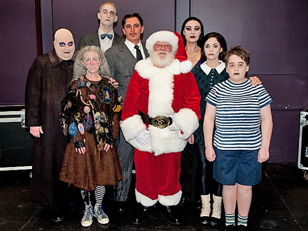Ho Ho Horrible! The Addams Family Snaps a Holiday Portrait with Santa Claus in Costa Mesa