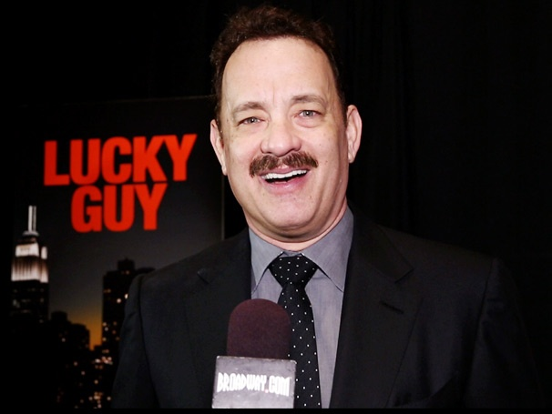See Lucky Guy Star Tom Hanks Speak French, Praise the Ensemble and Talk About His 'Bittersweet' Opening