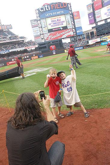 Will Swenson Sings at Mets Game - Will Swenson - sons (taking photo)