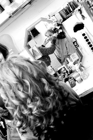 Girls in Jersey Boys – Heather Ferguson in the mirror with long wig