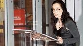 Time to present some awards! Emcee Janeane Garofalo steps up to the podium.