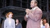 At the Ragtime opening night curtain call, Quentin Earl Darrington acknowledges the audience's applause, as Christiane Noll happily looks on.