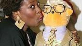 Fame Becomes me show stopper Capathia Jenkins pecks a fuzzy facsimile of Martin Short's Jiminy Glick.