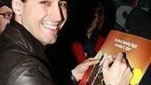 For another, John signs the Jersey Boys poster.