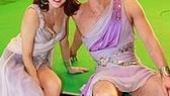 Xanadu dancers Kate Loprest and Ryan Watkinsonsit on the green-screened stage built for the shoot.
