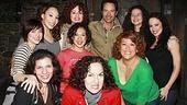 The women of In the Heights surround Eric McCormack.