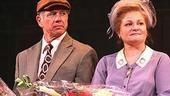 Onstage couple Tom Wopat and Faith Prince hold their lovely goodbye bouquets and listen intently as...