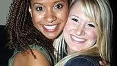 Rent's new Joanne, Tracie Thoms, gives Broadway baby Bailey Hanks a backstage squeeze.