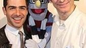 Adam Kantor gets surprised by Avenue Q puppet master Rick Lyon, who designed a special Mark-inspired puppet for Rent's big night.