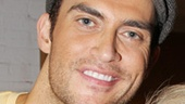Cheyenne Jackson greets another legendary guest, Joan Rivers.