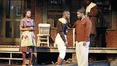 Viola Davis as Rose, Chris Chalk as Cory, Denzel Washington as Troy and Mykelti Williamson as Gabriel in Fences.