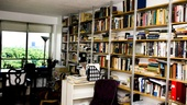 Three walls in Seldes' living room are lined with books and keepsakes. The fourth is a wall of windows offering a breathtaking view of Central Park.