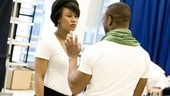 Christina Sajous confers with assistant choreographer Tyrone Jackson.
