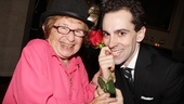 Aww, shucks! Sex therapist Dr. Ruth Westheimer, in a Chaplin bowler, offers Rob McClure a rose.