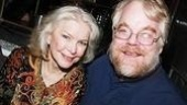 Little Flower director Philip Seymour Hoffman gets a little hug from Ellen Burstyn, who plays Therese.