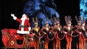 Here comes Santa Claus! The jolly bearded man takes a sleigh ride on stage accompanied by the Rockettes.