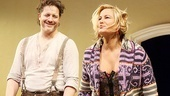 Brendan Fraser and Jennifer Coolidge grin widely during curtain call.