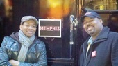 Derrick Baskin and James Monroe Iglehart pose outside the Memphis parade trailer.  