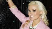 Holly Madison makes her mark on the show's backstage autograph wall. 