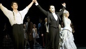 After the 23rd anniversary performance of The Phantom of the Opera, stars Sean MacLaughlin, Hugh Panaro and Sara Jean Ford take a bow.