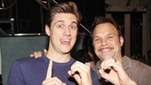 Hey, Aaron Tveit and Norbert Leo Butz: What are you celebrating? The Catch Me If You Can stars give us a sign signifying 100 Broadway performances.