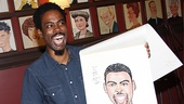 Ever the comedian, Chris Rock signs his Sardi's portrait,