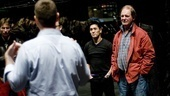 Production stage manager Rick Steiger advises Michael Morpurgo and fellow cast members on their blocking for the show's horse auction scene.
