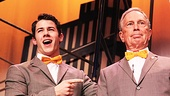 Bow-tied twosome Nick Jonas and Mayor Michael Bloomberg join their voices in song.