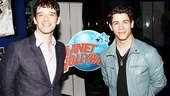 Onstage rivals Michael Urie (Bud Frump) and Nick Jonas (J. Pierrepont Finch) call a truce at Planet Hollywood