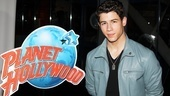 At Planet Hollywood, Nick Jonas looks out of this world in a blue leather jacket.