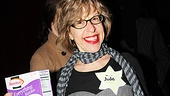 Comedian Jackie Hoffman proudly shows off her Jewish costume, complete with matzo, at Joel Grey's Cabaret party!