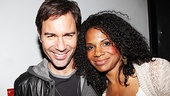 Eric McCormack and Audra McDonald share a smile backstage.