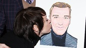 Mrs. Page can't resist giving her hubby's caricature a kiss.