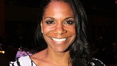 Porgy and Bess star Audra McDonald proudly poses with her Drama League Distinguished Performance Award.