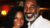 Porgy and Bess stars Audra McDonald and Norm Lewis are all smiles as Lewis awaits the unveiling of his Sardis portrait. 
