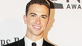 Ghost leading man Richard Fleeshman strikes a pose on the red carpet.