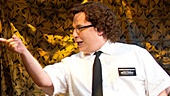 Jared Gertner as Elder Cunningham and the national tour cast in The Book of Mormon.