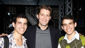 The Glee star is greeted by Newsies cast members (and real life twins) David and Jacob Guzman.