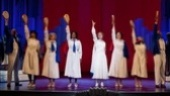 Carolee Carmello as Aimee Semple McPherson and the cast of Scandalous.