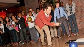 Let the bowling begin! Paul Rudd lets loose the first ball, cheered on by a big group of Our Time kids.