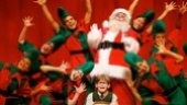 Eddie Korbich as Santa Claus, Johnny Rabe as Ralphie and company in A Christmas Story.
