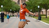 Mona Mostofi gets happy in front of Texas State Capitol.