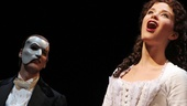 Hugh Panaro looks on as Sierra Boggess kicks off a special post-show performance of the musical's title song.