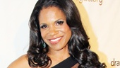 It's the lady of the hour! Audra McDonald looks dazzling in a Tadashi Shoji gown.
