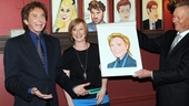 Barry Manilow is all smiles as American Theatre Wing's Heather Hitchens and Sardi's managing partner Max Klimavicius unveil his portrait.