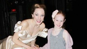 Birthday girl Grier Henchy tries on Laura Osnes glass slipper. 