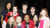 The Annie orphans are joined by J. Elaine Marcos (Lily, l.) and Brynn OMalley (Grace, c.) for a post-show snapshot.