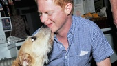 Jesse Tyler Ferguson gets a mouthful of Sunny the Dog, who gave a similar licking to Neil Patrick Harris on the Tonys!